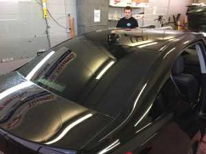 A car receiving auto glass tinting services